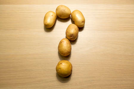 potato question mark table background nobody