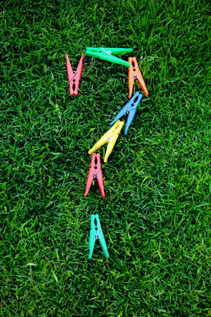 clothespin question mark green grass background nobody Imagens
