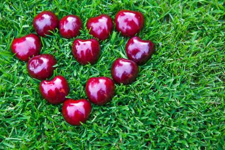 cherry berry heart symbol grass background nobody