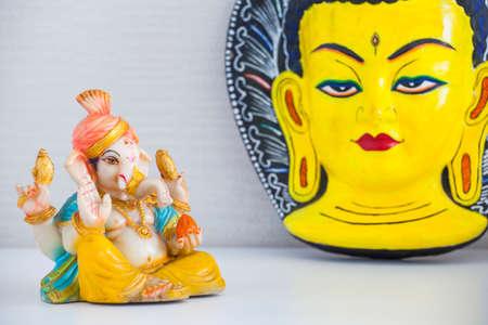 ceramic ganesha statue budha mask Stock Photo