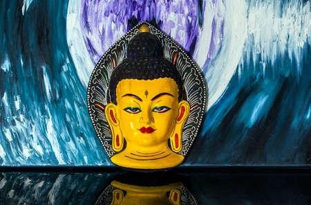 wooden buddha mask glass reflection Stock Photo