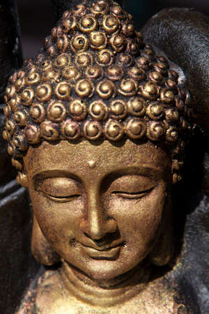 gold buddha face statue wall background