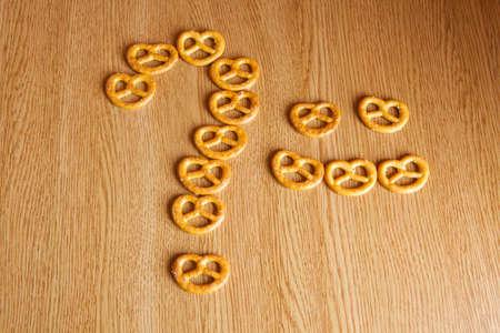 salt pretzel natural wooden background Stock Photo