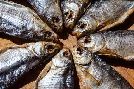 dried salt fish wooden background