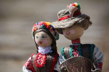 handmade doll wooden background Imagens