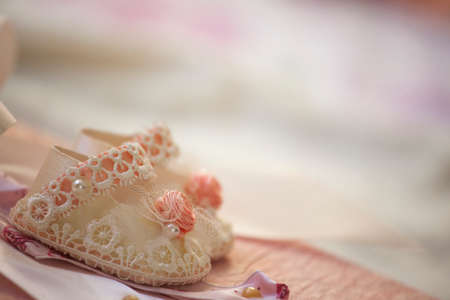 baby girl shoes paper background