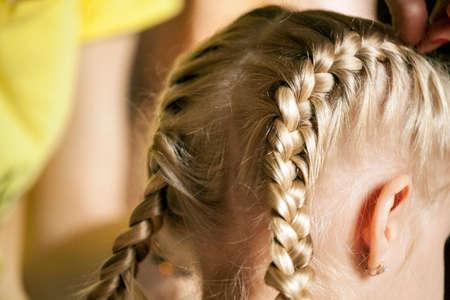 children girl hairstyle mother hand Standard-Bild