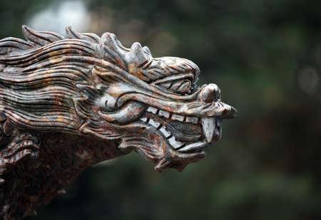 stone dragon statue tree background