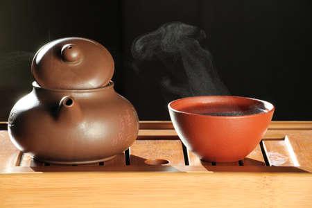 hot tea cup dark background