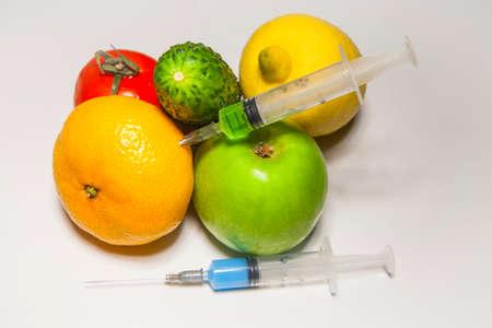 nitrate syringe fruit vegetable white background Foto de archivo