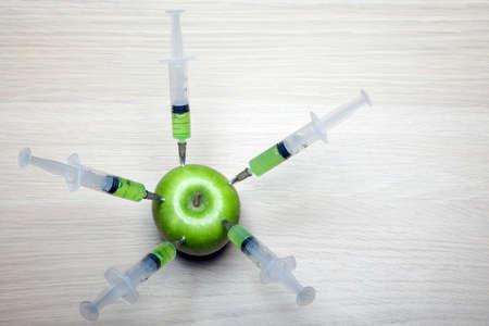 nitrate syringe apple table background