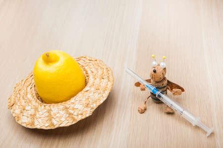 syringe lemon hat bee table background