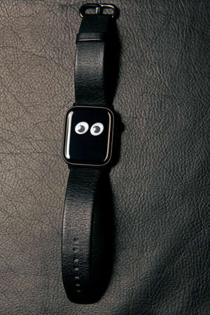 clock device dark leather background