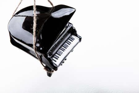 image of black piano rope white background