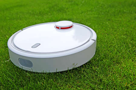 image of vacuum cleaner grass background