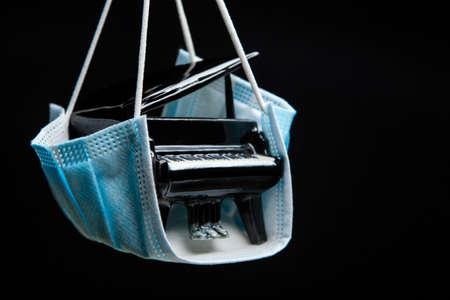 image of piano dark background