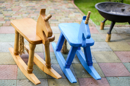 stool: A pair of handmade wooden horses. Stock Photo