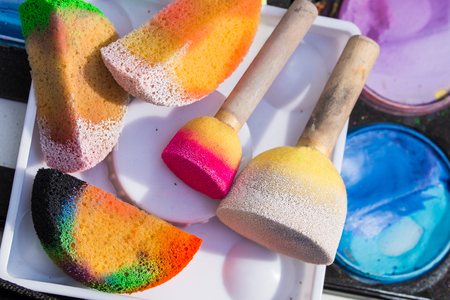 Color cosmetics, brushes and sponges for face painting. Children party Archivio Fotografico