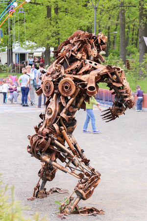 antique factory: Wild bear figure statue made of scrap metal and rusty gears. Central park, Bucha, Ukraine, 21st of May, 2017