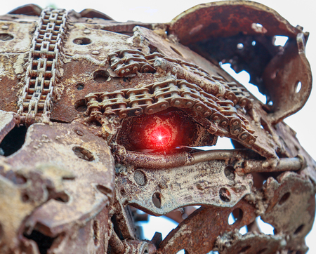 antique factory: Old rusty gears and industrial parts welded in a figures. The eye glows red.