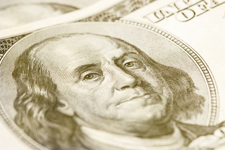 Macro close-up of Benjamin Franklins face on the US $100 dollar bill. Toned Stock Photo