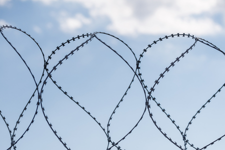 wire fence: Safe protective metal fence with barbed wire