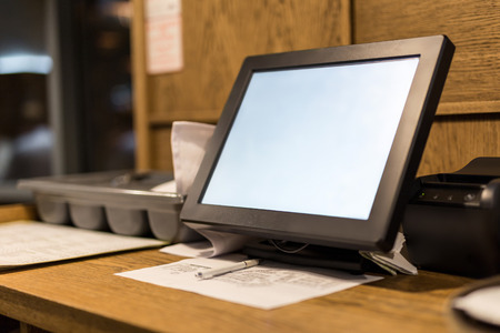 Point of sale POS touchscreen terminal.  Tablet for waiter to make and send orders.  Cafe administrator table with mobile printer and hall scheme. White empty screen for copy space