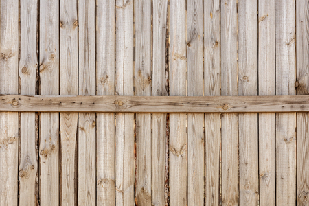 Close-up of vertical simple oak wooden fence background.  Old knotted timber wall. Vintage rustic pattern. Copyspace Banque d'images - 102726030