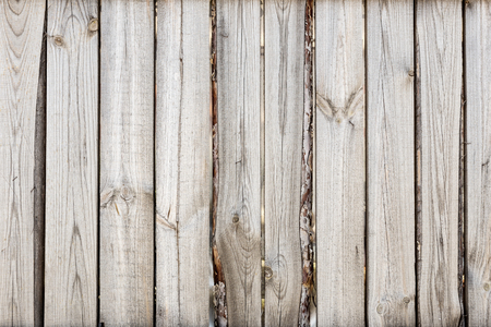 Close-up of vertical simple oak wooden fence background.  Old knotted timber wall. Vintage rustic pattern. Copyspace