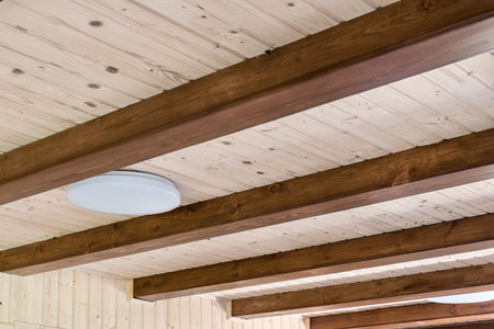 Rustic house ceiling with wide wooden beam support. Country home interior. Building natural decoration materials Stock Photo
