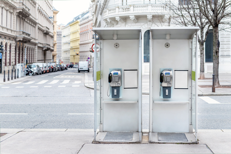 Pair of payphone booth in Vienna center street. Two modern public phones on european city street. copyspace