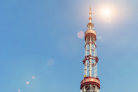Huge metal frame constuction of Kiev TV tower with blue clear sky on background on bright sunny day. Banco de Imagens