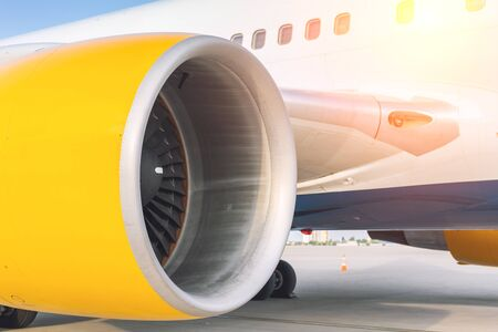 Close-up big commercial plane engine standing on airfiled after aircraft arrival on bright sunny day 写真素材