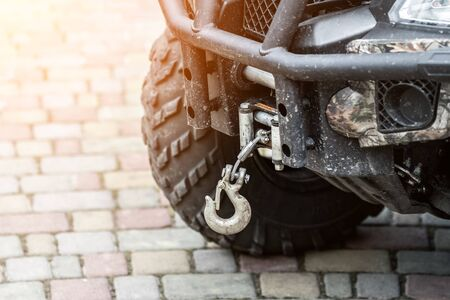 Close-up atv quadbike whick hook mounted on offroad all-terrain vehicle. Banque d'images