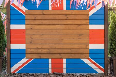 Wooden board with painted Great Britain Union jack flag. British country national symbol. Empty copy space for text in center.