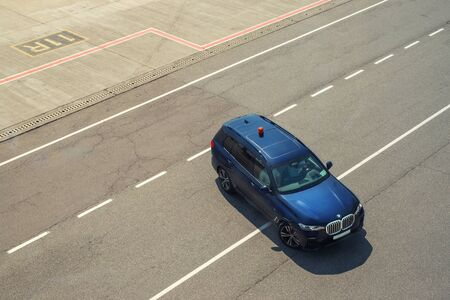 Kyiv, Ukraine - June16th, 2019: Newest big luxury BMW X7 SUV car as safety car with blinkers light bar on asphlat tarmac taxiway of Boryspil international airport. Large family vehicle. MB GLS rival Editorial