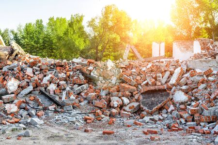 Close-up view ruins of old demolished industrial building. Pile of concrete and brick rubbish, debris, rubble and waste of destruction ruins of abandoned actory or plant. Earthquake city landscape