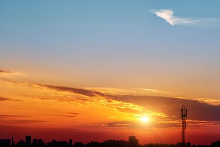 Dramatic colorful red purple to blue sunset or sunrise sky landscape with line row of city buildings silhouette . Natural beautiful cityscape dawn background wallpaper. Metropolis rise twilight time 版權商用圖片 - 148161873
