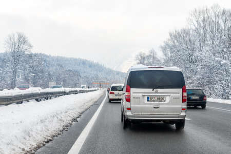 January 12th, 2019 - Salzburg, Austria: Winter highway with many different cars stucked in traffic jam due ti bad weather conditions. Vehicles on road heavy snowstorm and blizzard on cold winter day