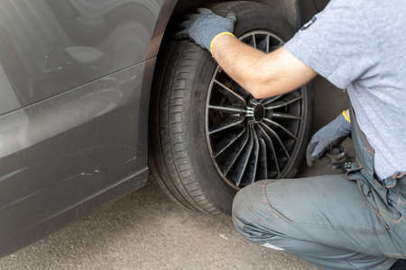 Car wheel repair shop outdoor ground . Seasonal winter tyre change at workshop. Vehicle tire repair, inspection and maintenance. Automotive garage for replace spare parts after failure breakdown