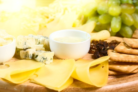 cheese platter: Various types of cheese on wooden platter Stock Photo