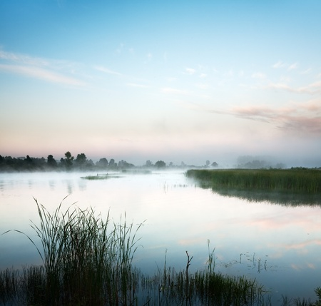 Landscape with lake and a morning fog