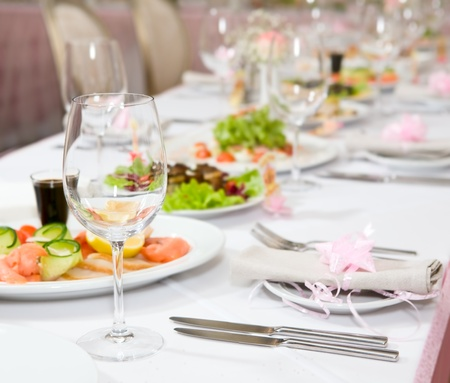 Modern tableware and glasses on a table photo