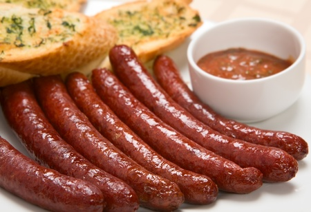 Grilled sausage with sauce on a plate Stock Photo