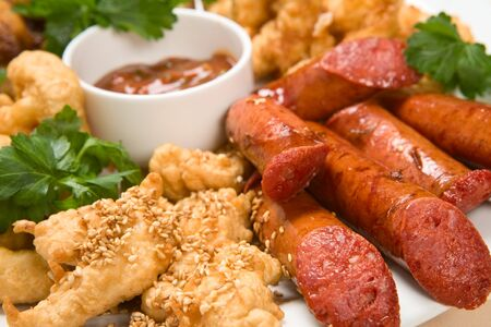 Grilled sausage with sauce and chicken Stock Photo
