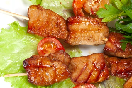 barbecue with sauce and vegetables photo