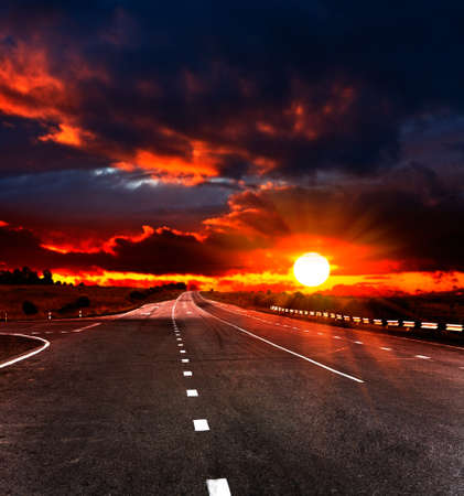 landscape with road and cloudy sky photo