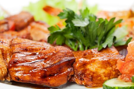 barbecue with sauce and vegetables Standard-Bild