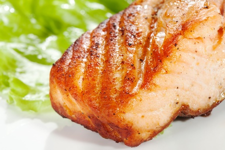 grilled salmon on white plate photo
