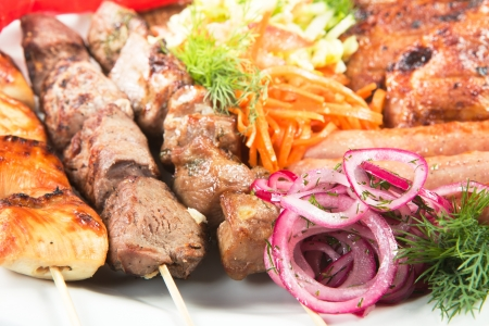 barbecue with sauce and vegetables Stock Photo
